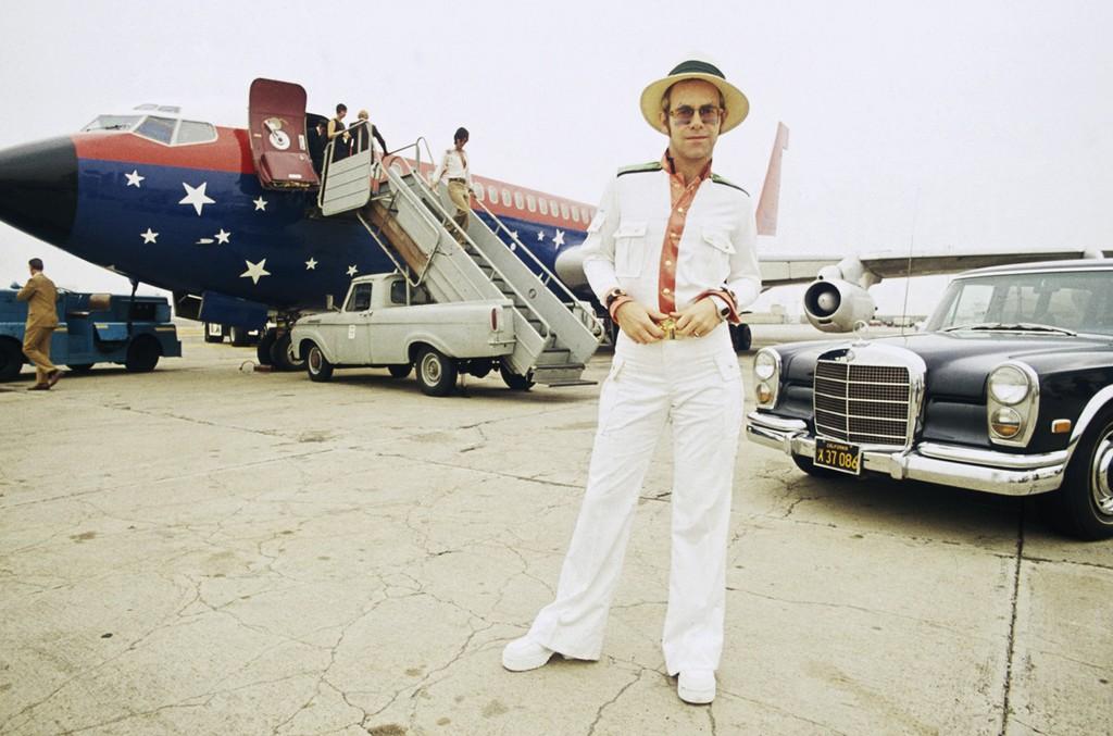 Elton John on an airport runway in California during his 1974 US tour.