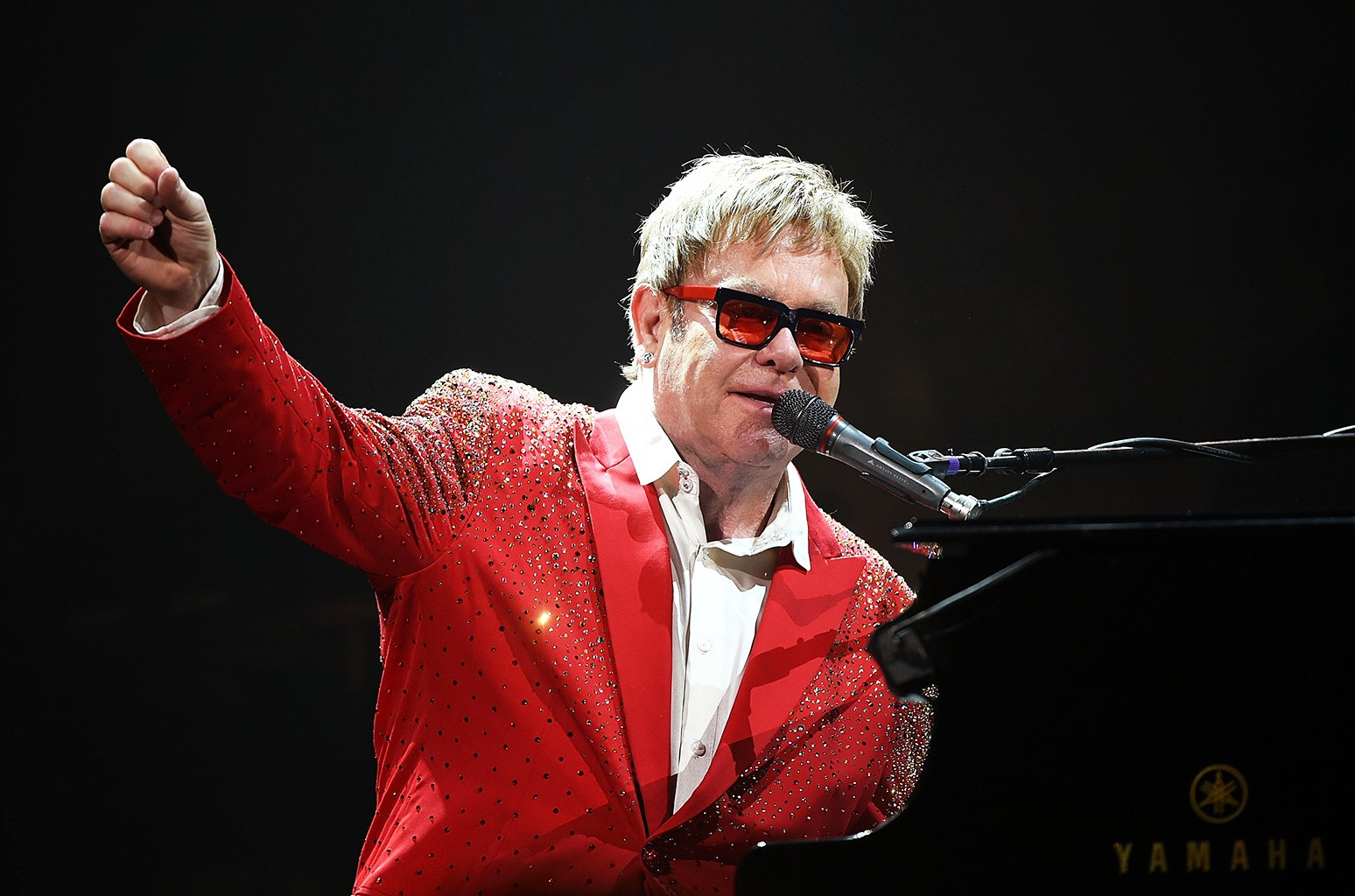 Elton John performs on Dick Clark's New Year's Rockin' Eve with Ryan Seacrest 2015 on Dec. 31, 2014 in New York City.