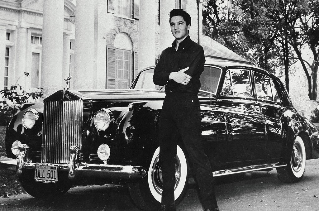 Elvis with Rolls Royce in front of his villa 'Graceland' in Memphis, Tennessee.