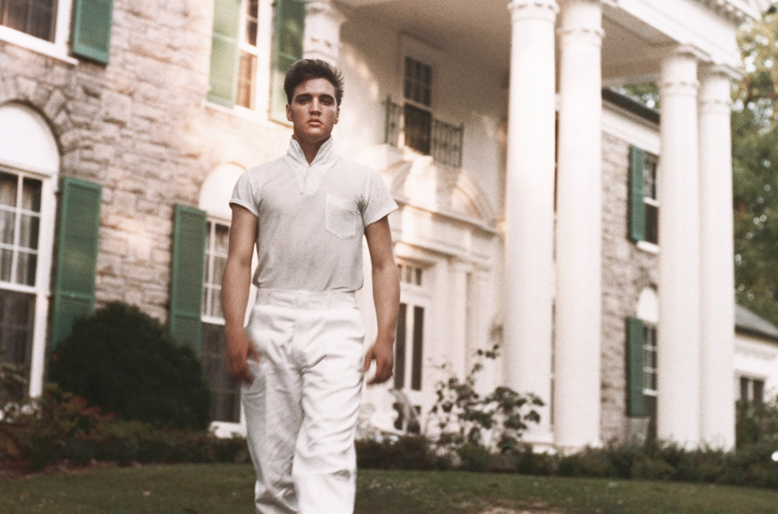 Elvis Presley strolls the grounds of his Graceland estate in circa 1957.