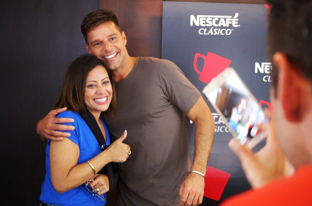 Ricky Martin poses with a fan during NESCAFÉ Clásico's Break the Routine in Miami on June 6, 2016.