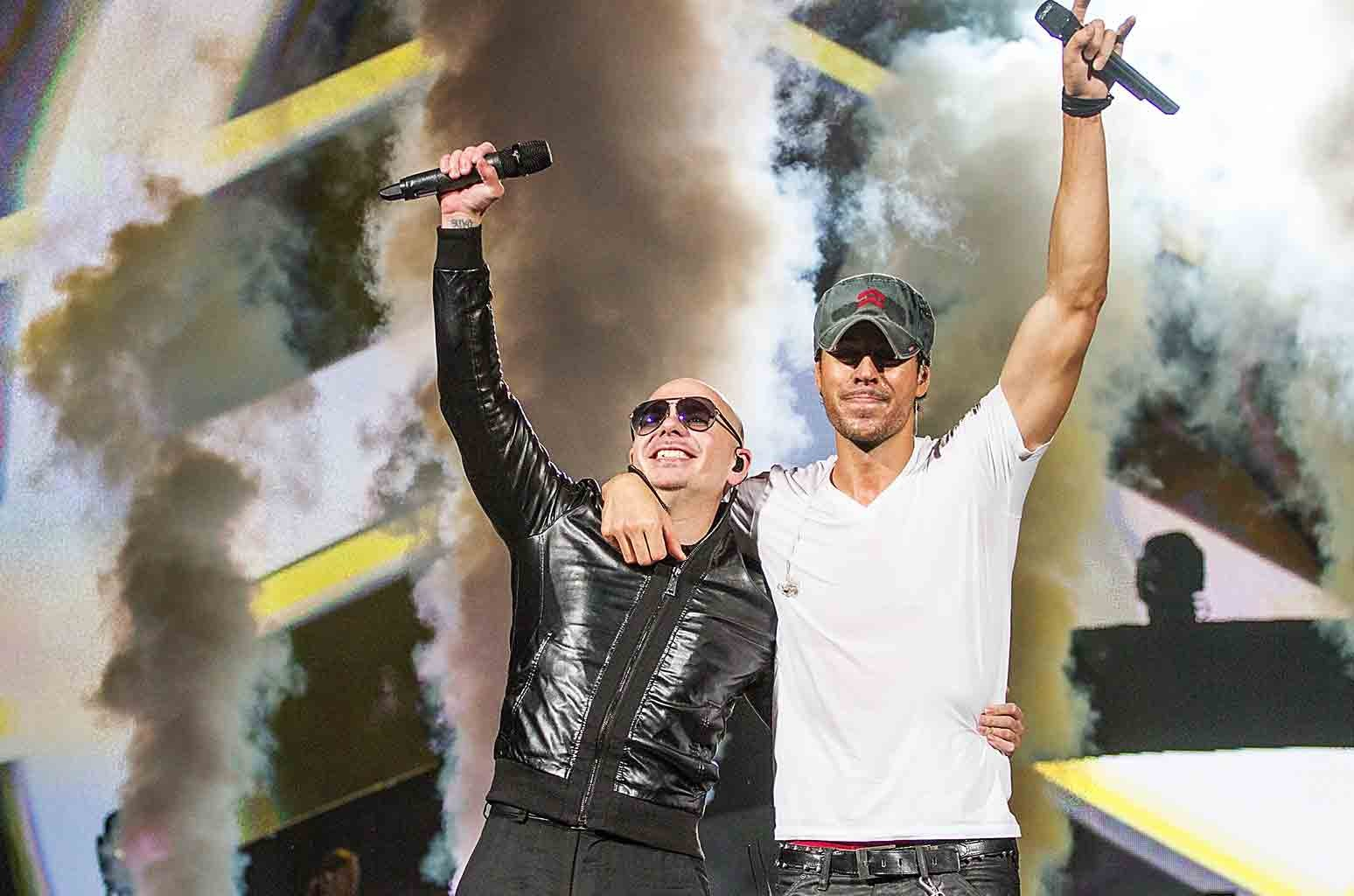 Pitbull and Enrique Iglesias perform in concert at The Frank Erwin Center on Feb. 7, 2015 in Austin, Texas.