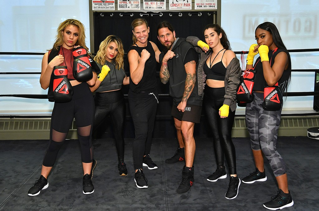 Fifth Harmony with Rob Piela, owner of Gotham Gym, and Inga Stenta, Reebok Director of Brand Management.