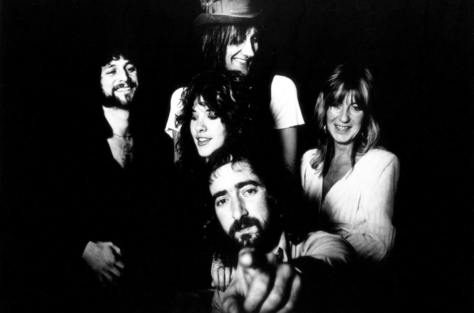 "Lindsey Buckingham, Mick Fleetwood, Christine McVie, John McVie and Stevie Nicks (center) of the rock and roll group ""Fleetwood Mac"" pose for a portrait in circa 1977."