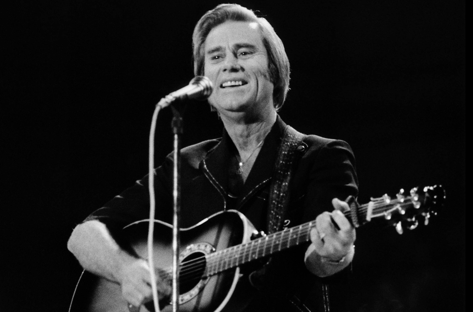 George Jones performs live on stage at the Country Music Festival at the Wembley Arena in London in April 1981.