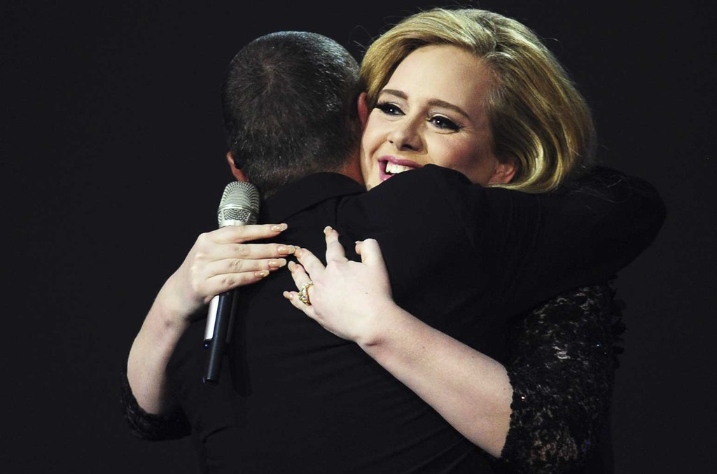 "Adele hugs presenter singer George Michael as she accepts the British Album of the Year award for her album ""21"" at the BRIT Awards 2012 in London on Feb. 21, 2012."