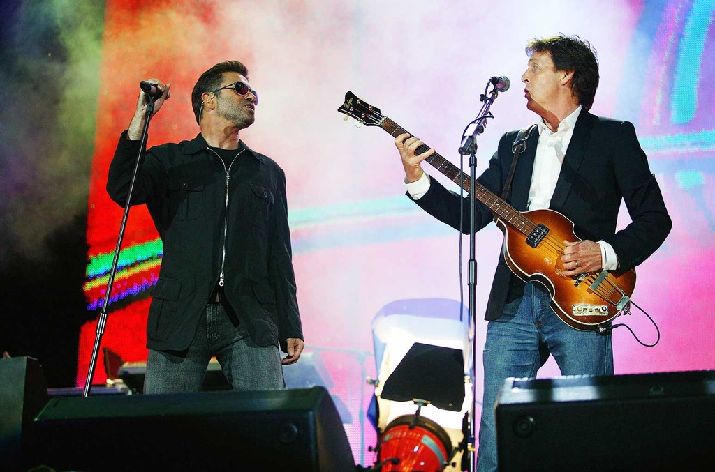 George Michael and Paul McCartney performing live onstage at Live 8 in 2005.