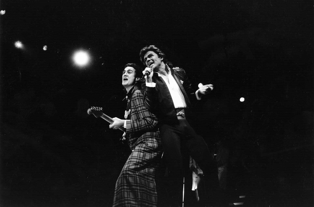 George Michael and Andrew Ridgeley of pop group Wham! during a live performance.