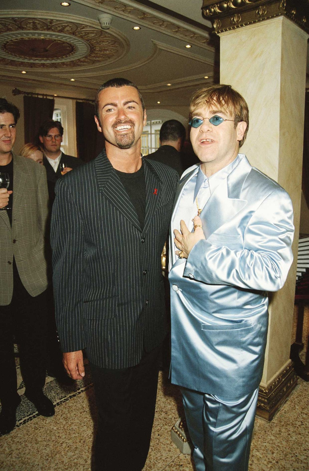 George Michael and Elton John at the Gianni Versace 'Men Without Ties' launch party in London on June 15, 1995.
