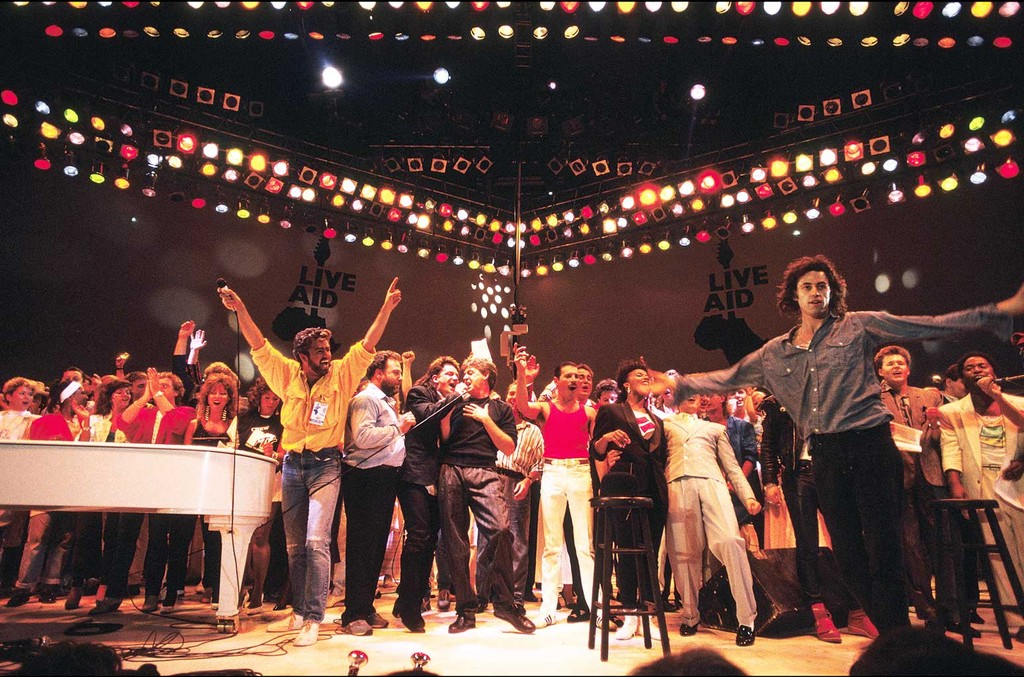 George Michael, Bono, Paul McCartney, Freddie Mercury and Bob Geldof perform on stage during the Live Aid concert at Wembley Stadium on July 12, 1985 in London, England.