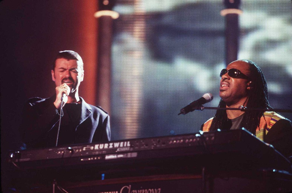 George Michael performs with Stevie Wonder at the 4th annual VH-1 Honors Awards on April 10, 1997.