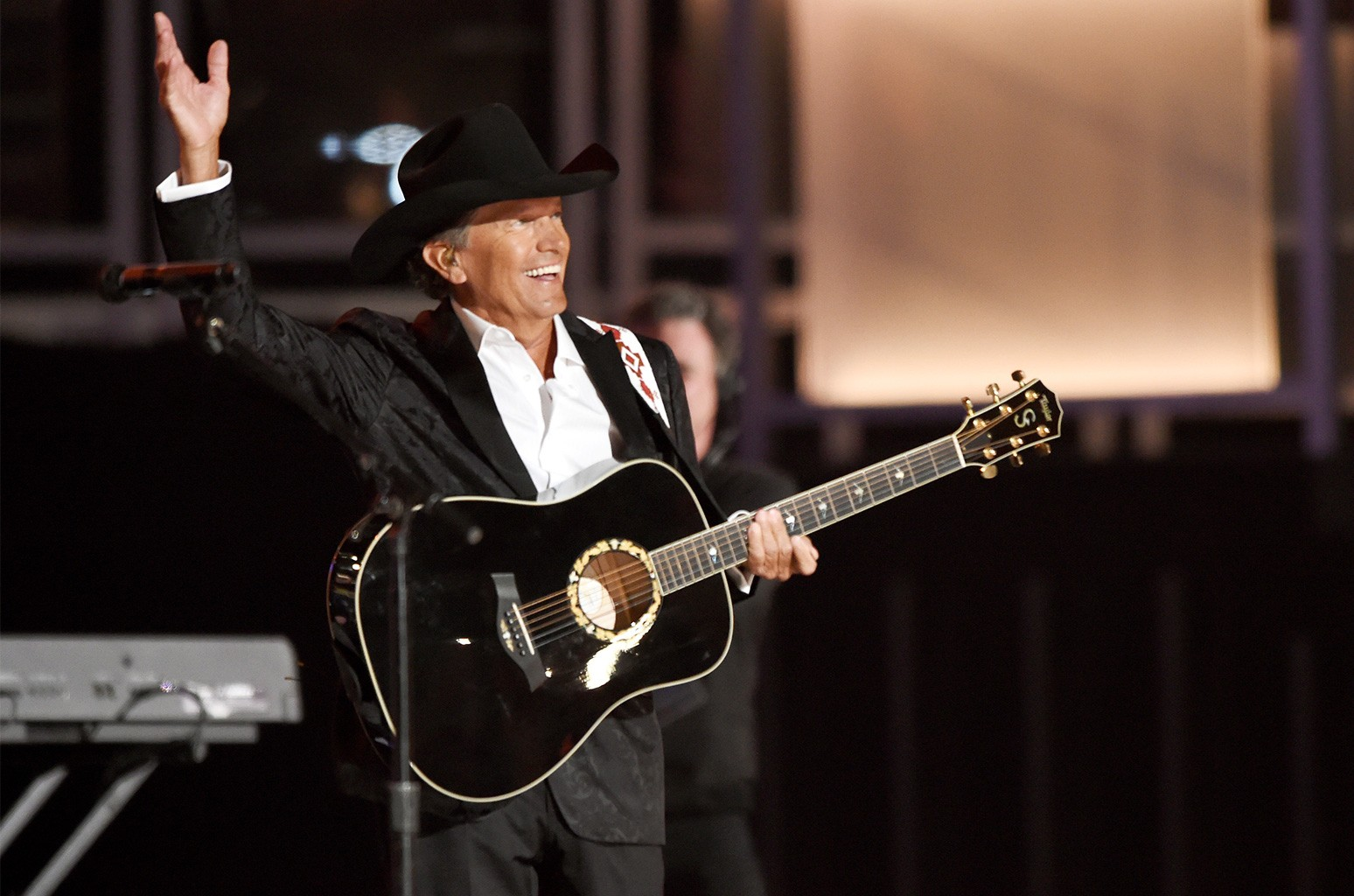 George Strait accepts the 50th Anniversary Milestone Award onstage during the 50th Academy of Country Music Awards at AT&T Stadium on April 19, 2015 in Arlington, Texas.