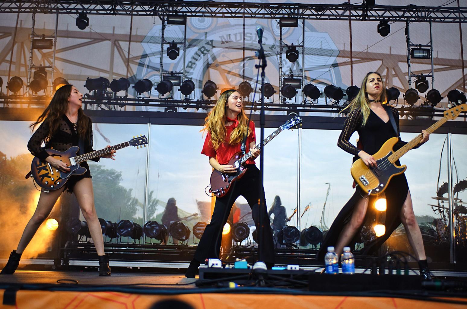 Danielle, Alana and Este Haim of Haim performs performs at the Bunbury Festival on June 3, 2016 in Cincinnati, Ohio.