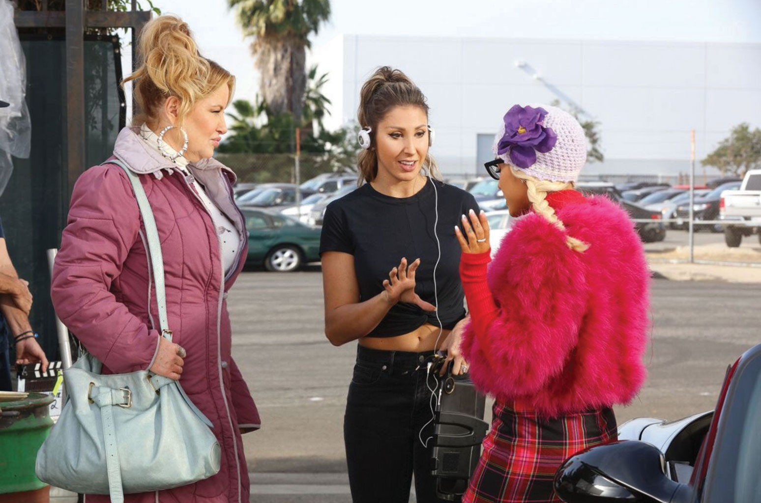"""From left: Jennifer Coolidge, Davis and Grande on the set of the """"ThankU, Next"""" music video."""