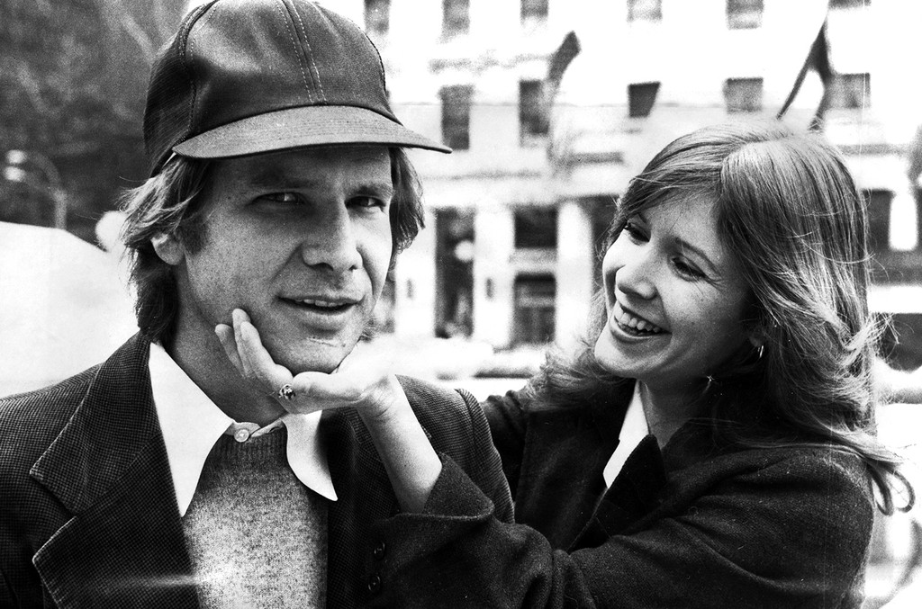 "Harrison Ford and Carrie Fisher on Fifth Ave outside The Plaza hotel. They were in town for the movie ""Star Wars."""