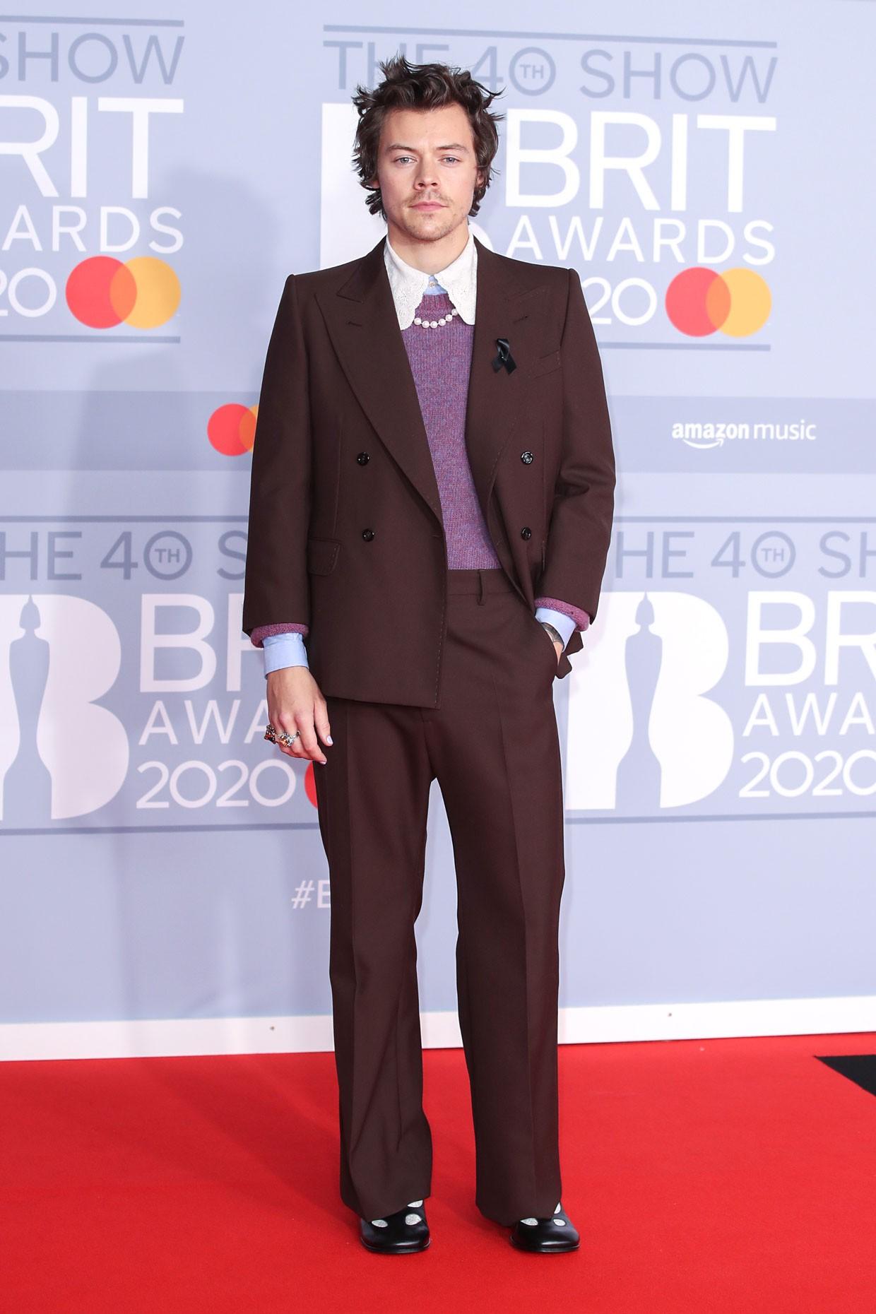 harry styles channels professor plum on brit awards red carpet billboard brit awards red carpet