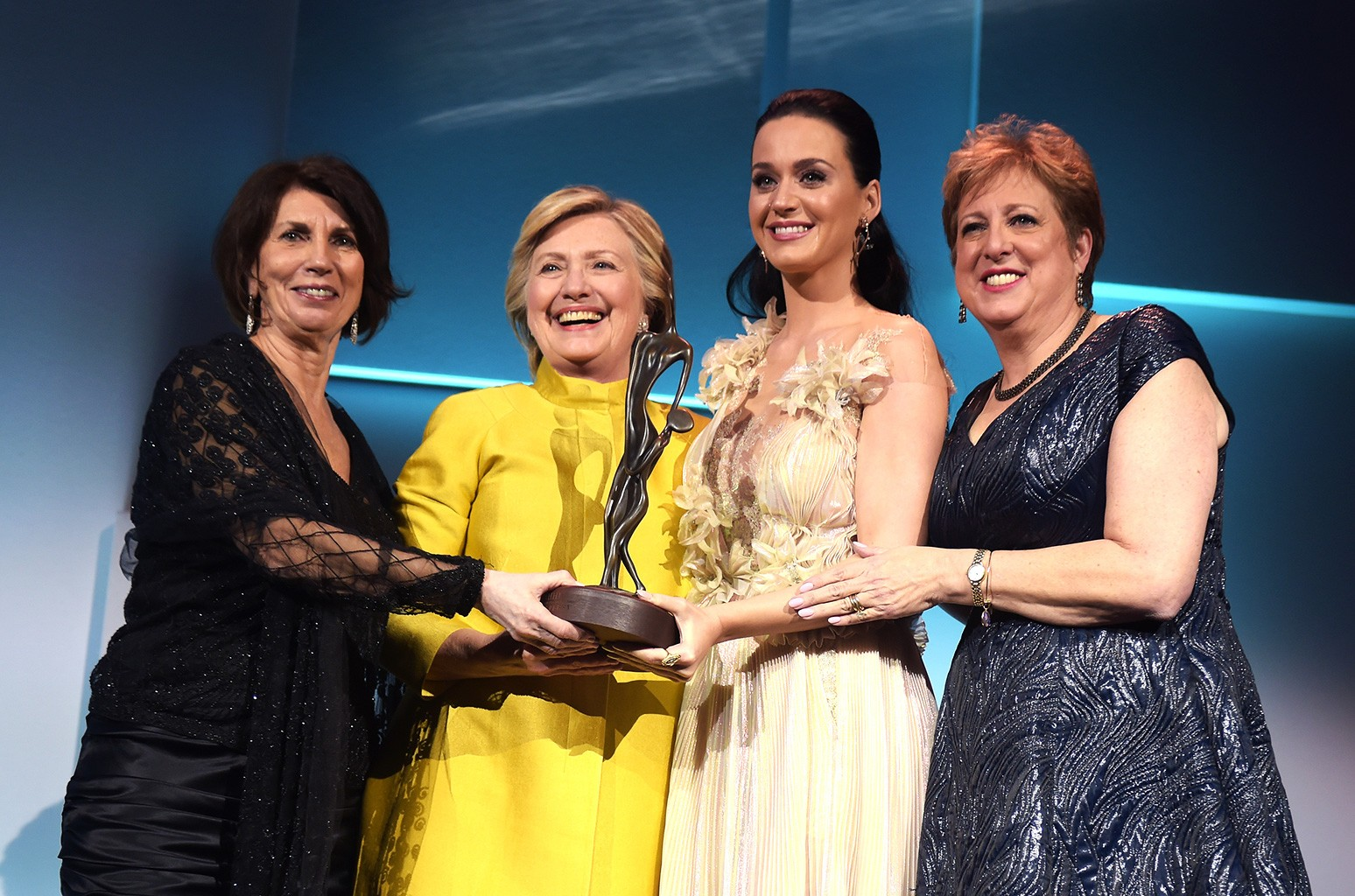 Pamela Fiori, Hillary Clinton, Katy Perry, and Caryl Stern speak on stage during the 12th annual UNICEF Snowflake Ball at Cipriani Wall Street on Nov. 29, 2016 in New York City.
