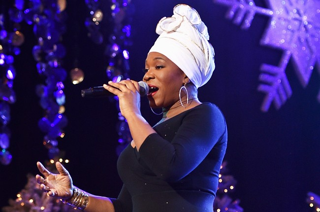 India Arie performs onstage during 2015 Hollywood Christmas Parade