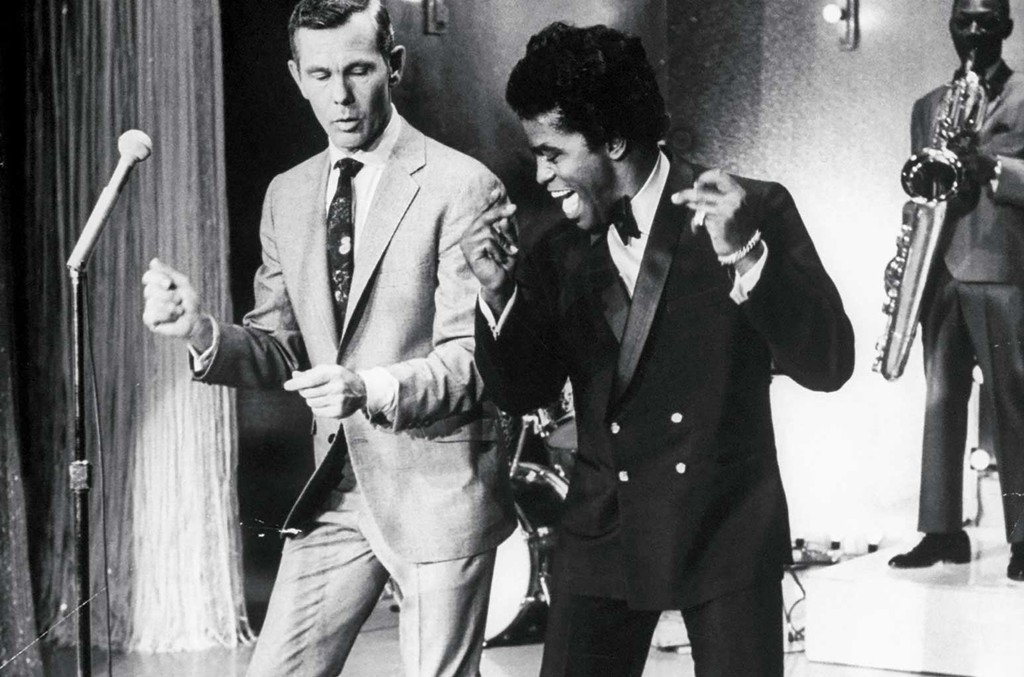 James Brown teaching talk show host Johnny Carson how to dance.