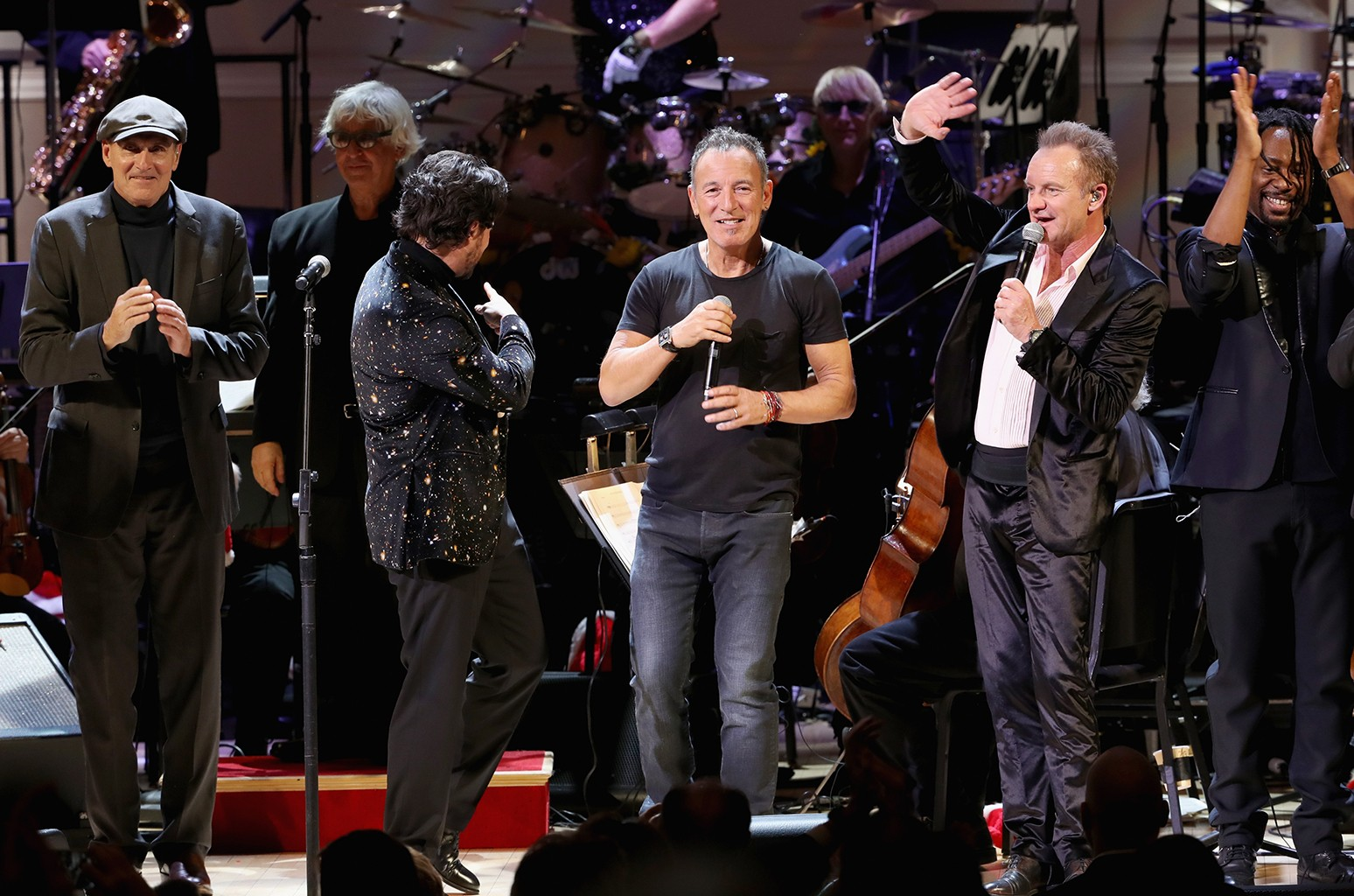 """James Taylor, Vittorio Grigolo, Bruce Springsteen, and Sting perform onstage during The Revlon Concert for the Rainforest Fund """"Baby It's Cold Outside"""" at Carnegie Hall on Dec. 14, 2016 in New York City."""