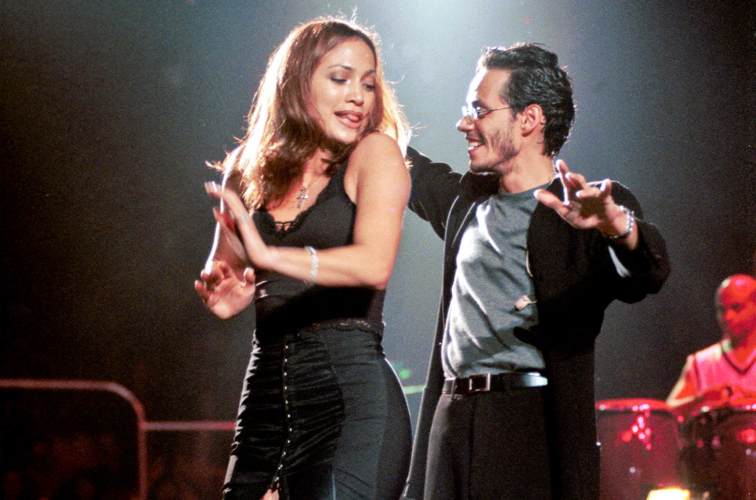 Marc Anthony performs onstage with Jennifer Lopez