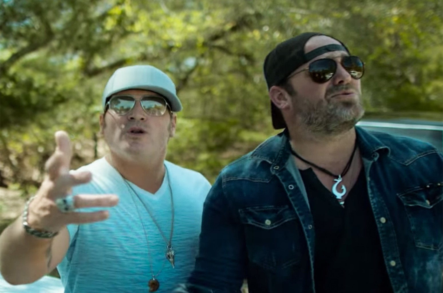 "Jerrod Niemann and Lee Brice in the video for ""A Little More Love."""