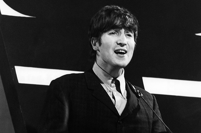 John Lennon performing with The Beatles