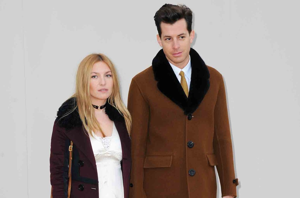 Josephine de La Baume and Mark Ronson attend the Burberry show during The London Collections Men AW16 at Kensington Gardens on Jan. 11, 2016 in London, England.