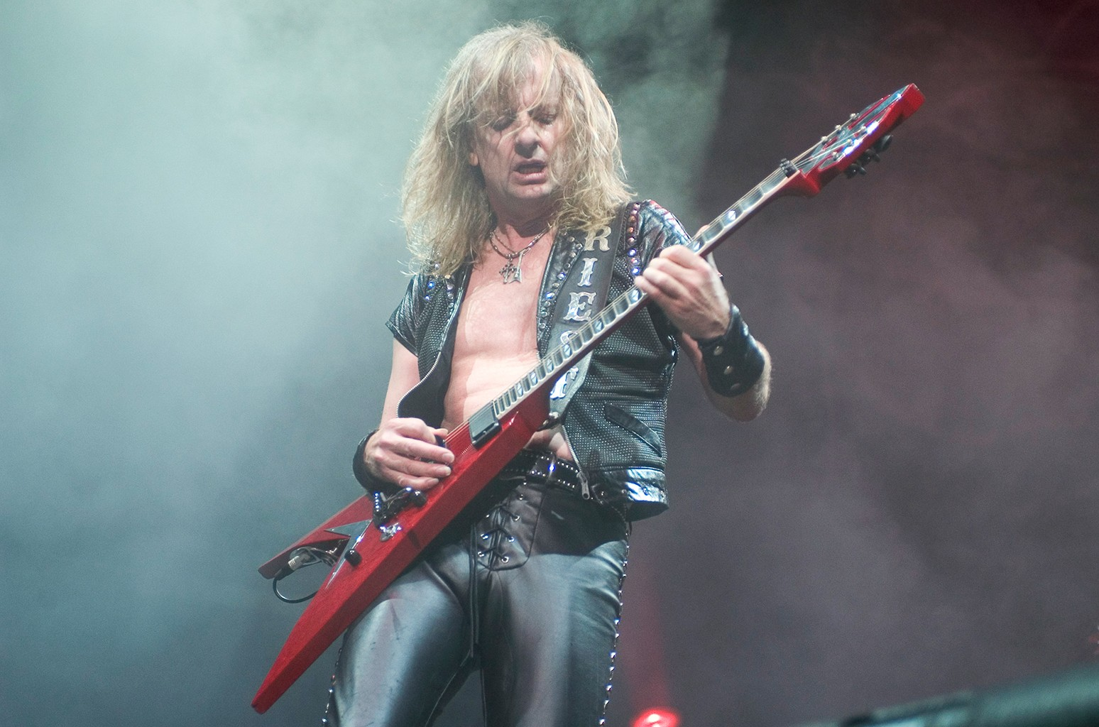 KK Downing of Judas Priest perform onstage at the Tweeter Center in Chicago on Aug. 21, 2004.