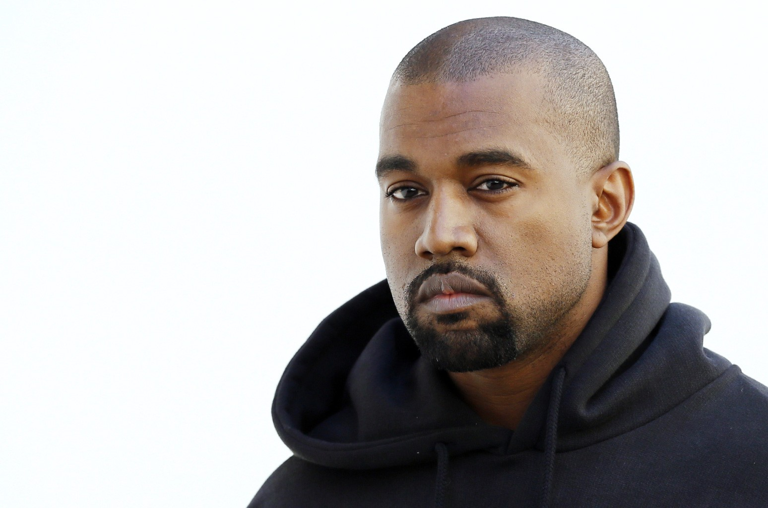 Kanye West poses before Christian Dior 2015-2016 fall/winter ready-to-wear collection fashion show on March 6, 2015 in Paris.