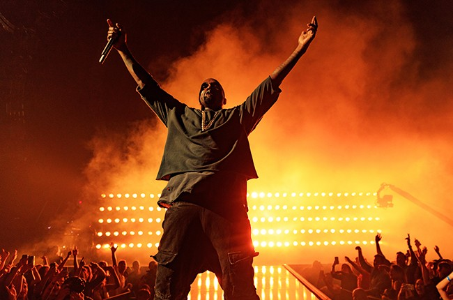 Kanye West performs onstage at the 2015 iHeartRadio Music Festival