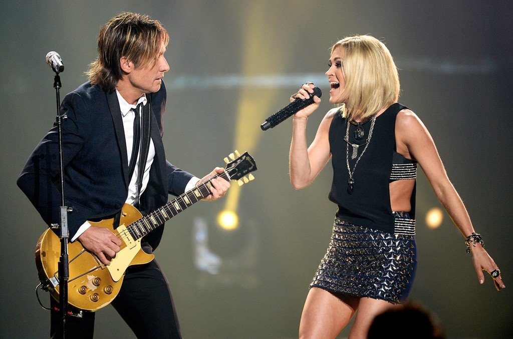 "Keith Urban and Carrie Underwood perform onstage during FOX's ""American Idol"" Finale For The Farewell Season at Dolby Theatre on April 7, 2016 in Hollywood, Calif."