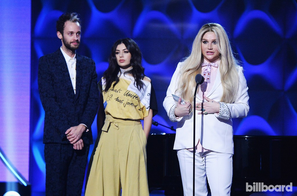 Wrabel, Charli XCX, and Kesha on stage at the Billboard Women in Music 2016 event on Dec. 9, 2016 in New York City.