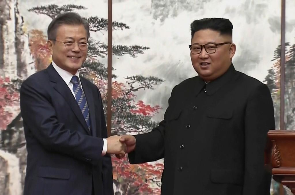 North Korean leader Kim Jong Un, right, and South Korean President Moon Jae-in