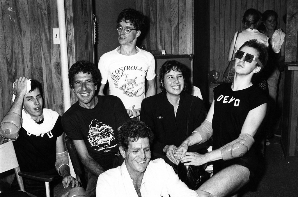Leonard Cohen, David Blue, Mark Mothersbaugh of Devo, Martine Getty and a Devo member backstage at The Starwood in Los Angeles in 1970.