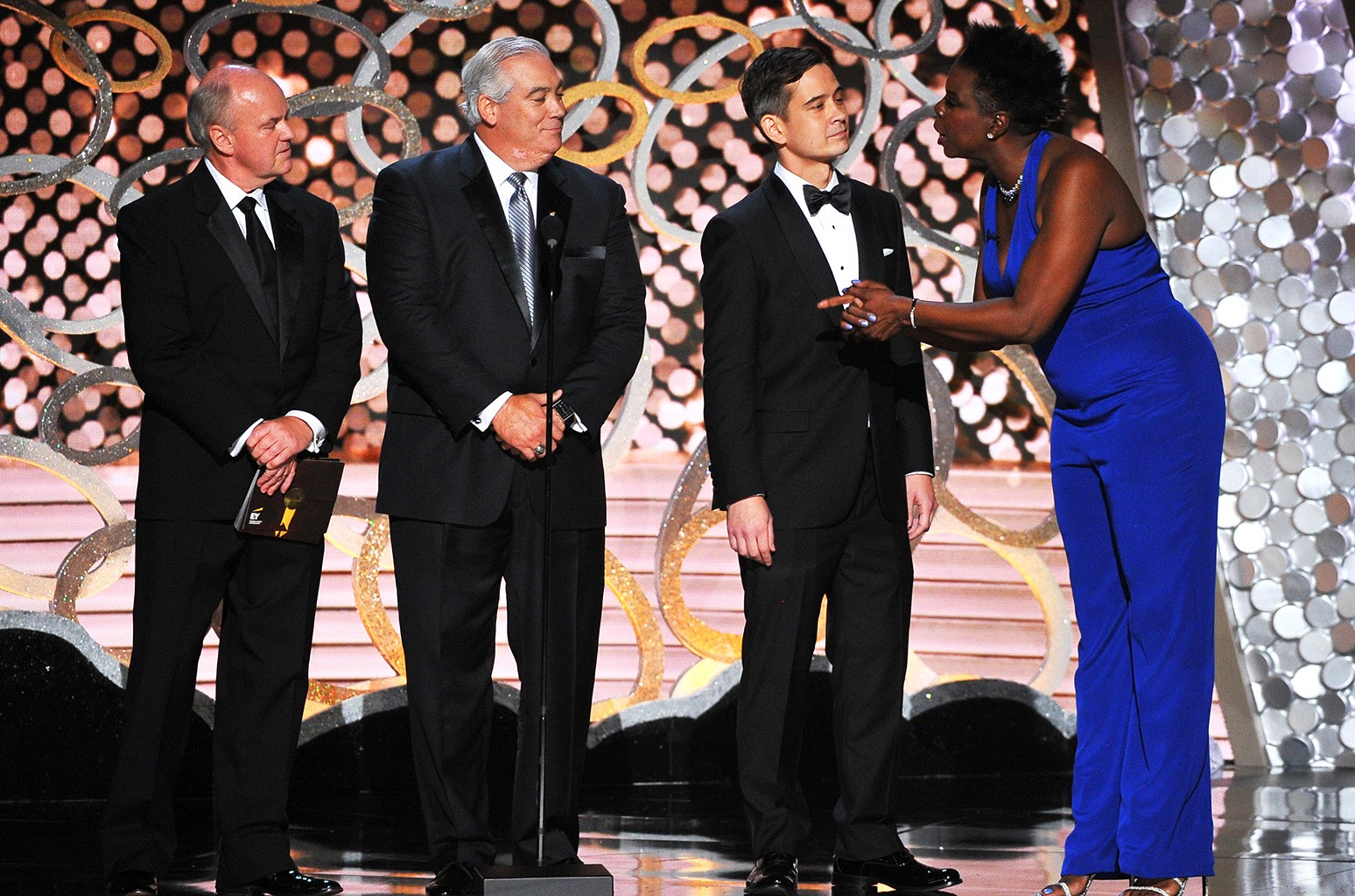Leslie Jones and accountants from Ernst & Young appear on stage at the 68th Primetime Emmy Awards on Sept. 18, 2016 at the Microsoft Theater in Los Angeles.