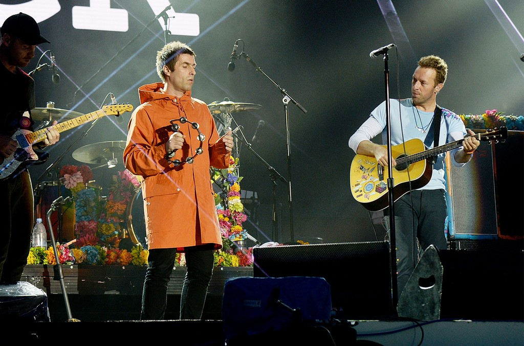 Liam Gallagher and Chris Martin of Coldplay perform on stage during the One Love Manchester Benefit Concert at Old Trafford on June 4, 2017 in Manchester, England.