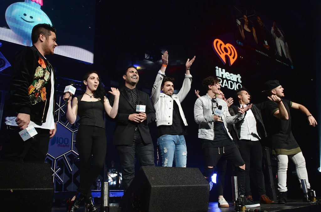 adio Host Mack of Mack in the Afternoon, Emily Estefan and Los 5 speak onstage at the Y100's Jingle Ball 2016 at BB&T Center on Dec. 18, 2016 in Sunrise, Fla.