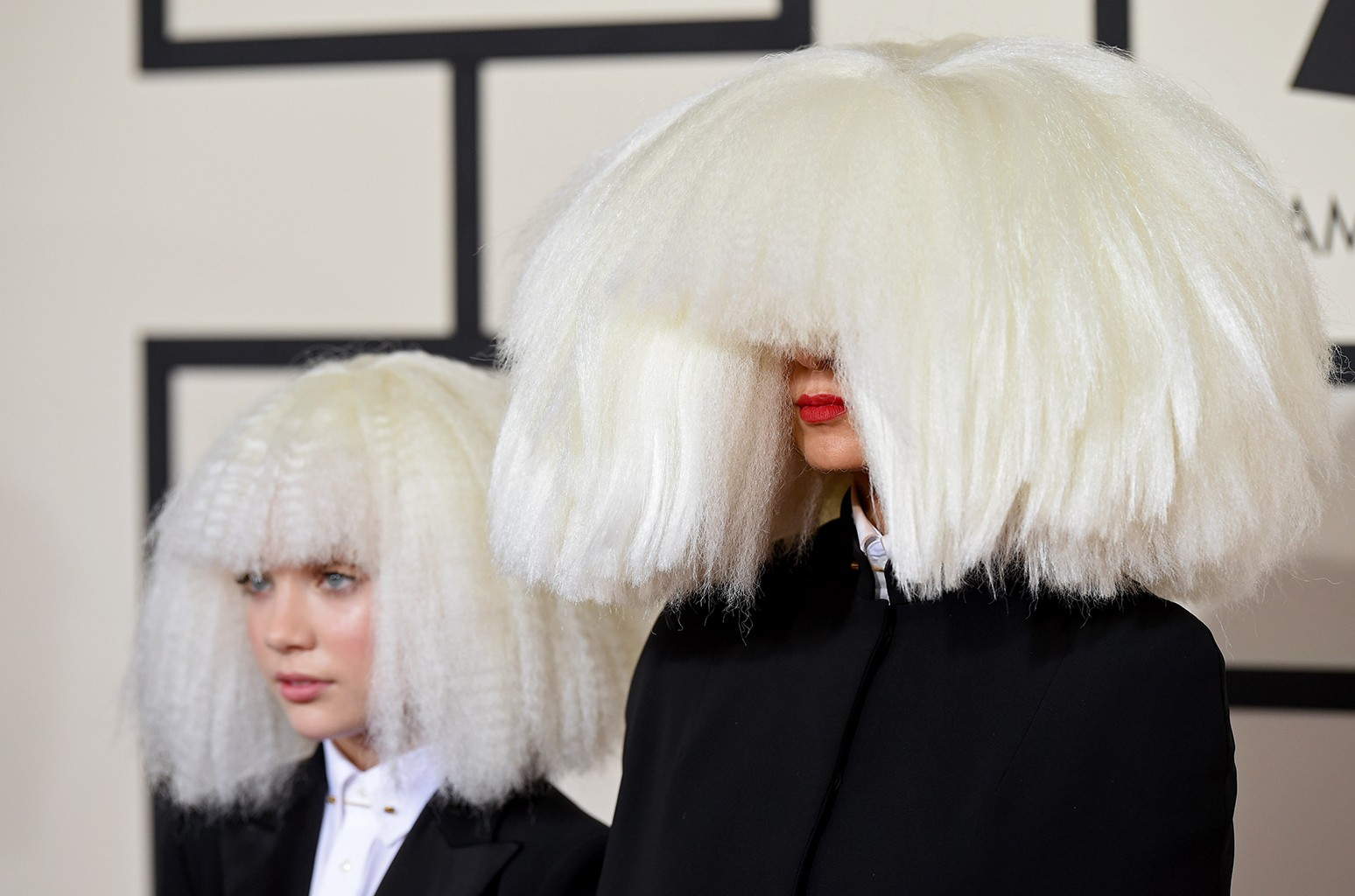 Maddie Ziegler and Sia arrive at the 57th Annual Grammy Awards at Staples Center on Feb. 8, 2015 in Los Angeles.