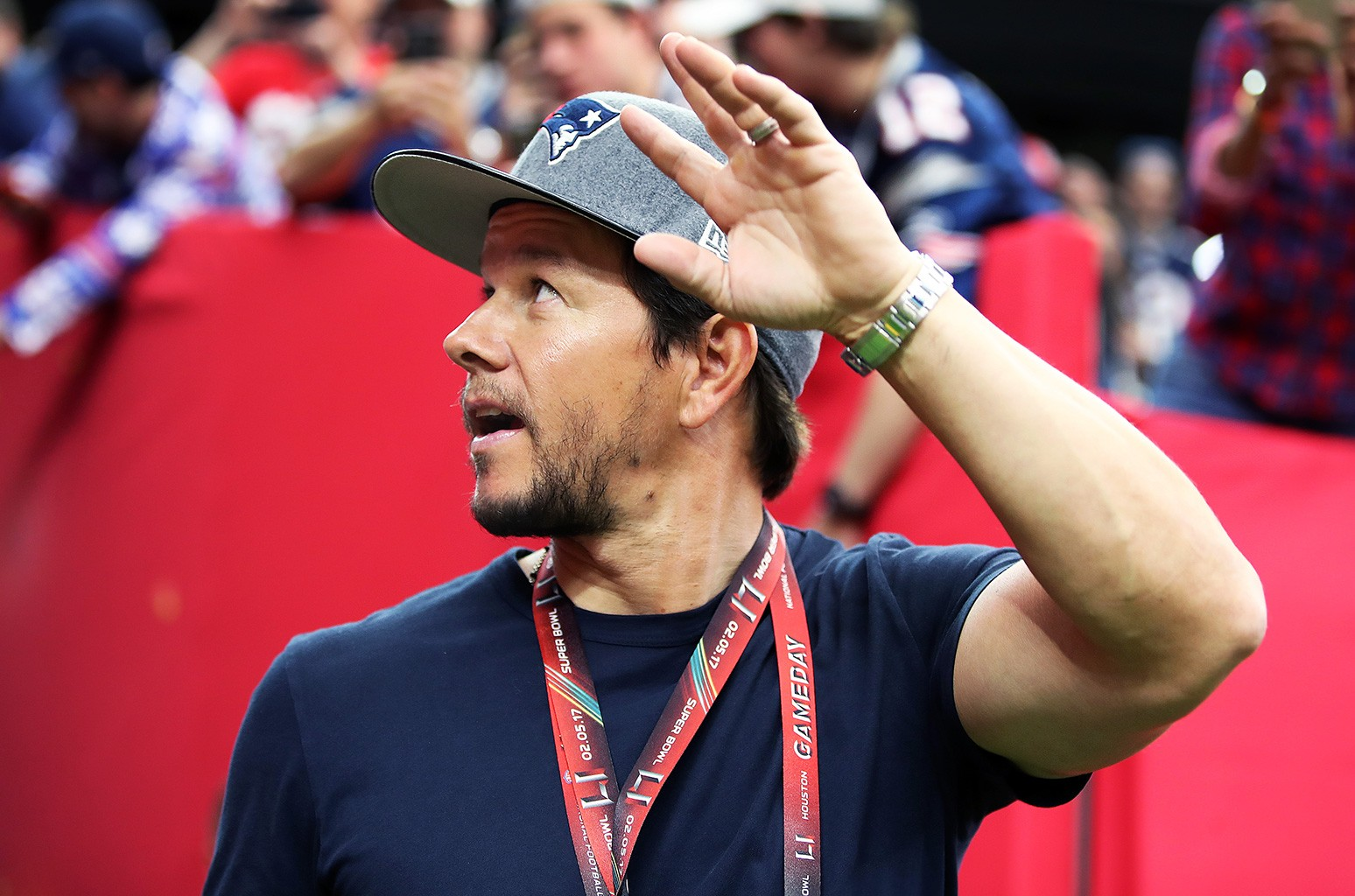 Mark Wahlberg waves to fans who are calling his name as he walks onto the field during pre game warm ups. The Atlanta Falcons play the New England Patriots in Super Bowl LI at NRG Stadium in Houston on Feb 5, 2017.