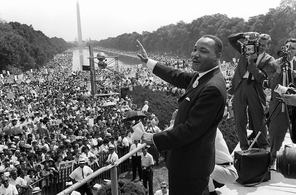 US civil rights leader Martin Luther King, Jr., waves to supporters from the steps of the Lincoln Memorial on Aug. 28, 1963 on The Mall in Washington, DC.