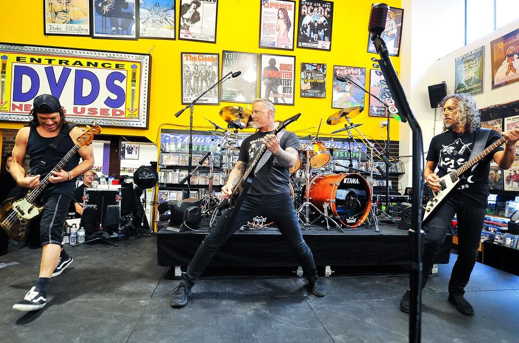 Robert Trujillo, James Hetfield and Kirk Hammett of Metallica perform on Record Store Day at Rasputin Music on April 16, 2016 in Berkeley, Calif.