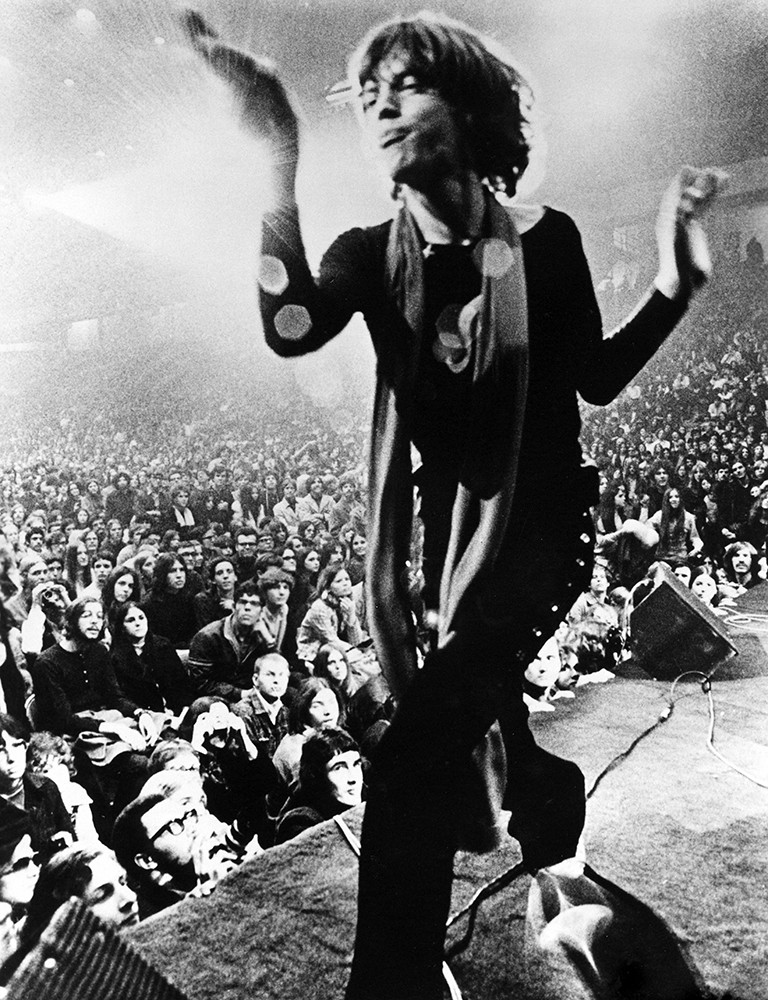 Mick Jagger performing on stage with the Rolling Stones in 1969.