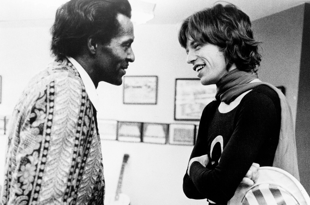 """Mick Jagger chats backstage with Chuck Berry at Madison Square Garden in a concert that was recorded and later released as the live album """"Get Yer Ya-Ya's Out"""" and also as part of the film """"Gimme Shelter"""" on Nov. 28, 1969 in New York City."""