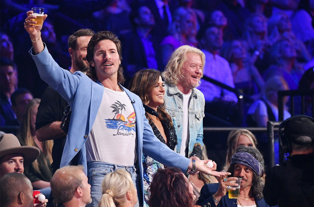 Mark Wystrach of musical group Midland, Jimi Westbrook, Karen Fairchild and Phillip Sweet of musical group Little Big Town host the 2019 CMT Music Awards at Bridgestone Arena on June 5, 2019 in Nashville.