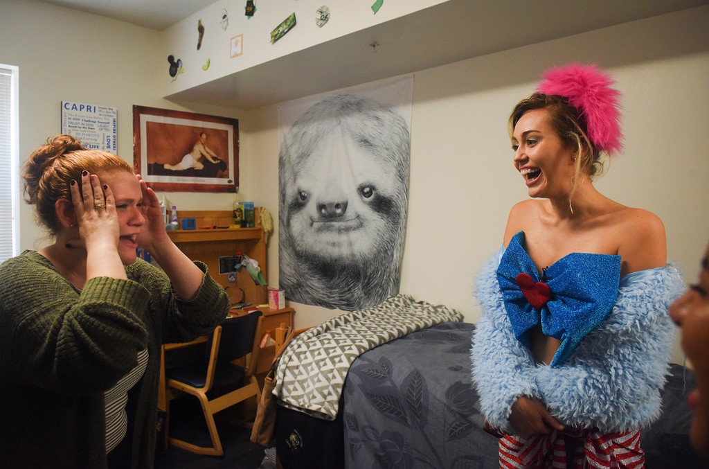 GMU student Katherine Quigley gets a visit from Miley Cyrus as Cyrus makes a campaign visit for Hillary Clinton and Tim Kaine in Northern Virginia at George Mason University on Oct. 22, 2016 in Fairfax, VA.
