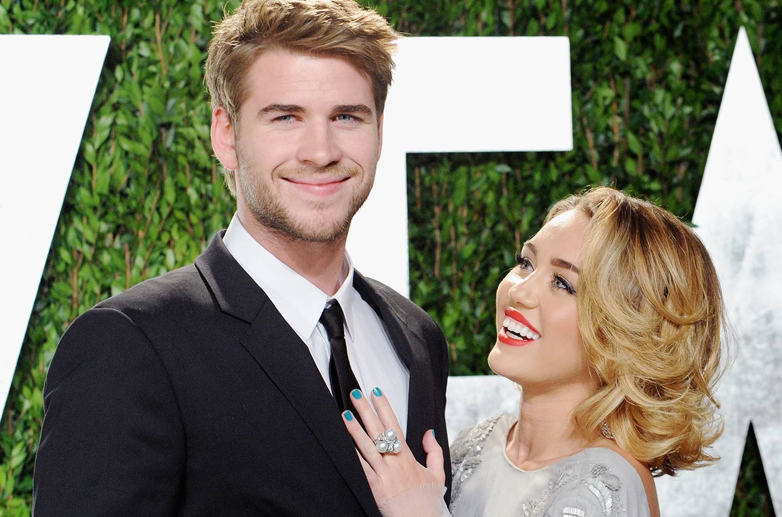 Liam Hemsworth and Miley Cyrus arrive at the 2012 Vanity Fair Oscar Party at Sunset Tower on Feb. 26, 2012 in West Hollywood, Calif.