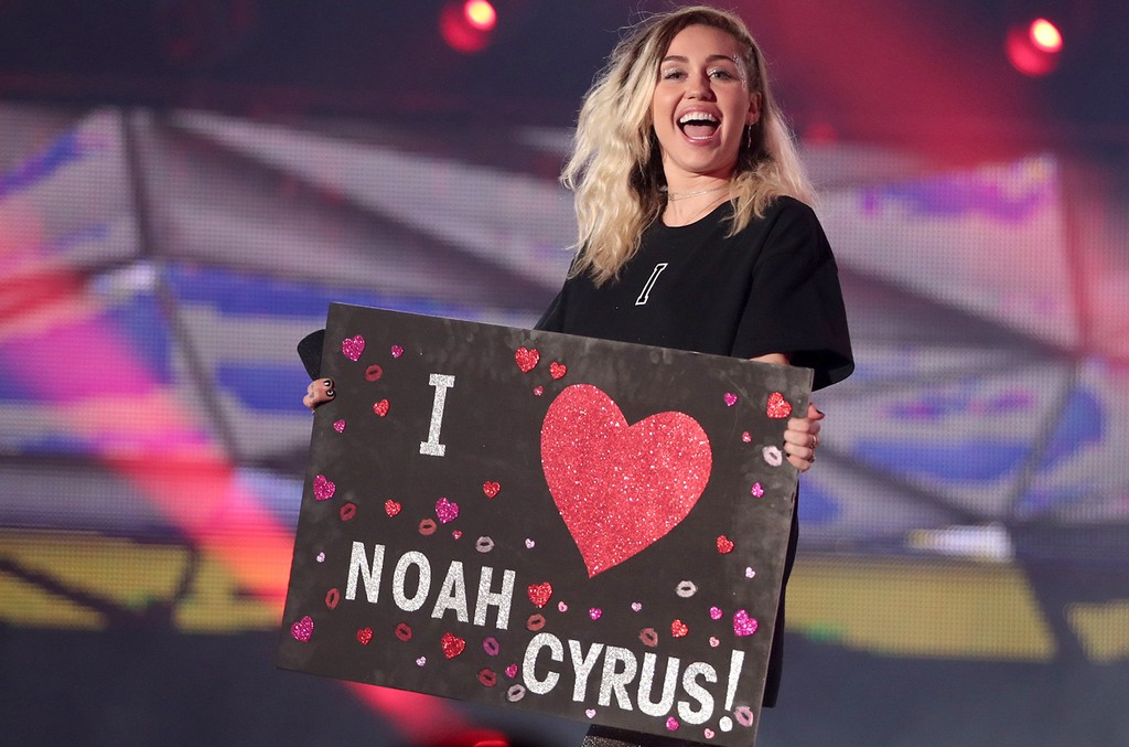Miley Cyrus holds a sign reading 'I heart Noah Cyrus' while she speaks onstage at the 2017 iHeartRadio Music Awards which broadcast live on Turner's TBS, TNT, and truTV at The Forum on March 5, 2017 in Inglewood, Calif.