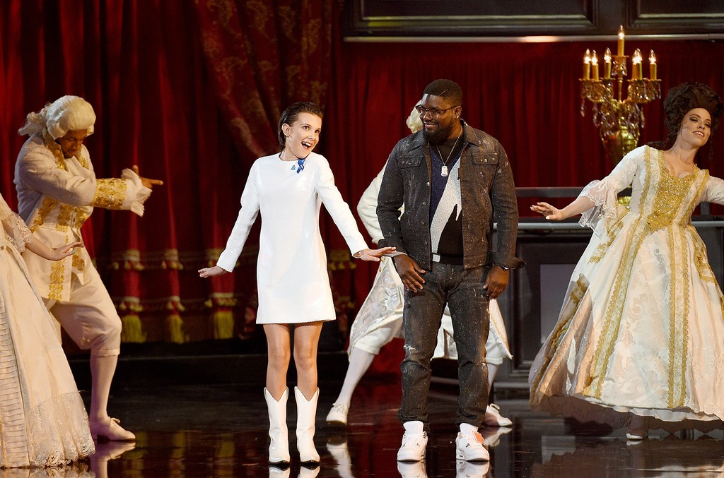 Millie Bobby Brown (L) and Lil Rel Howery onstage during the 2017 MTV Movie and TV Awards at The Shrine Auditorium on May 7, 2017 in Los Angeles.