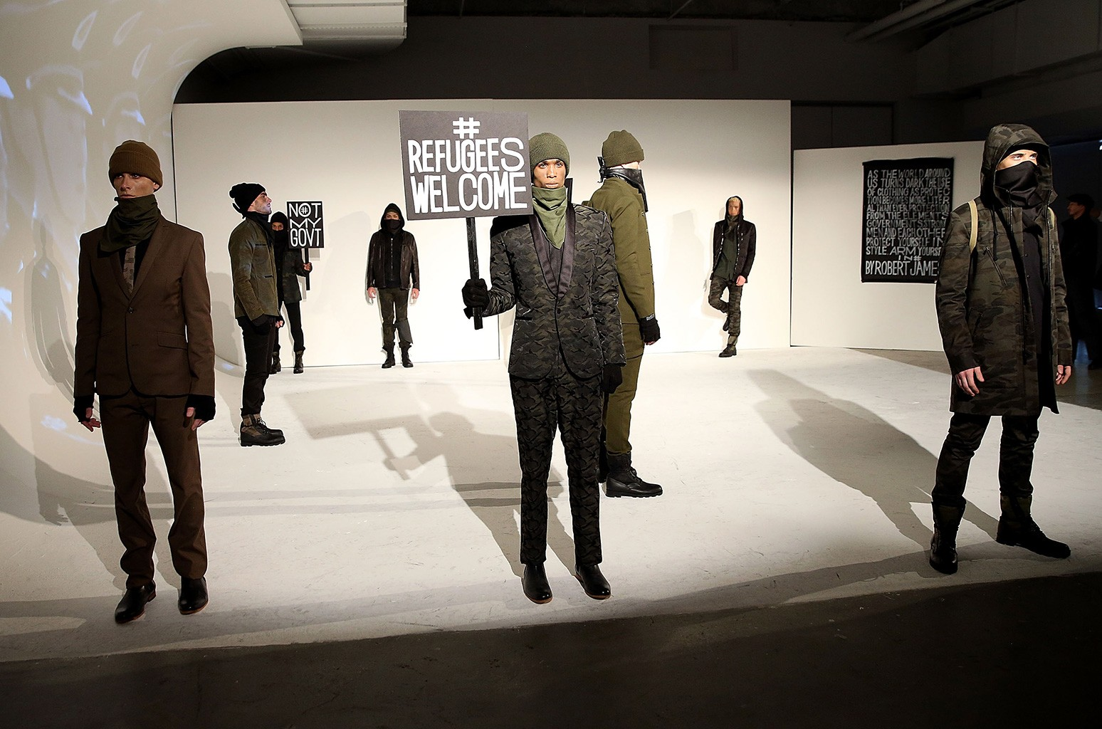 Models pose at By Robert James Presentation during NYFW: Men's on Jan. 30, 2017 in New York City.